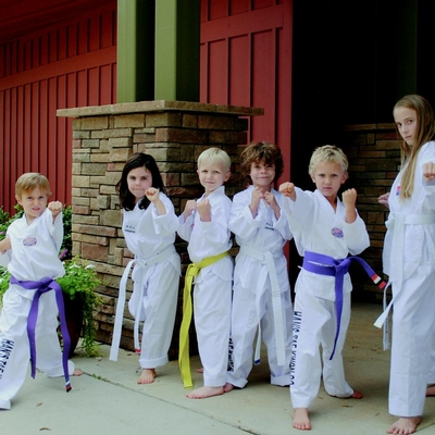 students in tae kwon do uniforms